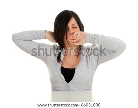 yawning stretching woman in grey sweatshirt and black blouse