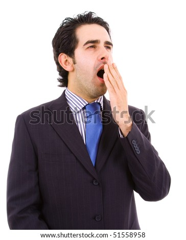 yawning young business man, isolated on white background
