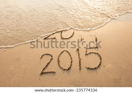 Year 2015 Coming written on the beach #235774336