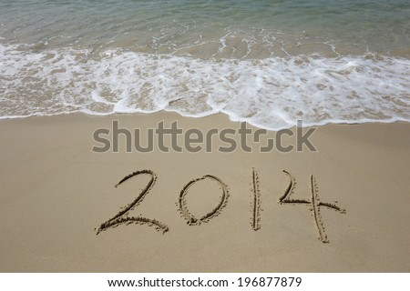 Year 2014 hand written on the white sand in front of the sea #196877879