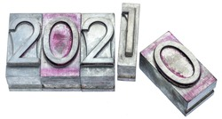 year 2001 is replacing 2020 - number abstract in gritty vintage letterpress metal types isolated on white, calendar and New Year concept
