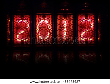Year 2012 shown by numerical vacuum tubes, also known as Nixie tubes. Pink glowing numbers on black background. - stock photo