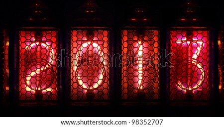 Year 2013 shown by numerical vacuum tubes, also known as Nixie tubes. Pink glowing numbers on black background.
