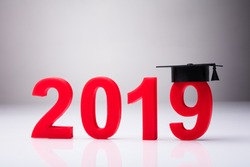 Year 2019 With Graduation Hat On White Background