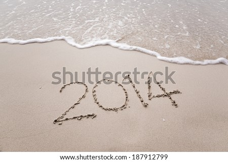 Year 2014 written in sand, on krabi beach ,Thailand #187912799