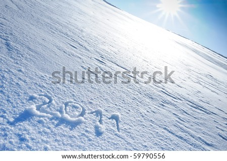 Year 2011 written in Snow with Sun