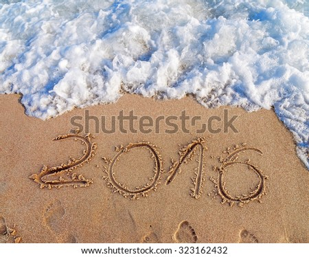 Year 2016 written in the sand on a beach #323162432