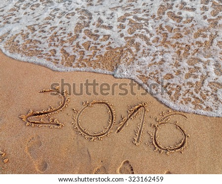 Year 2016 written in the sand on a beach #323162459