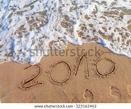 Year 2016 written in the sand on a beach #323162462