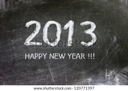 Year 2013 written in white chalk on a blackboard. #120771397