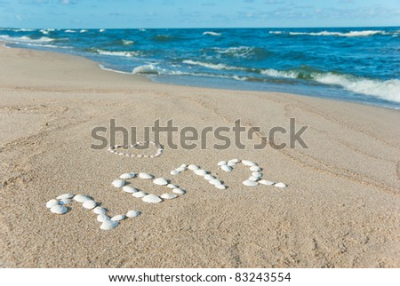 year 2012 written on sand with seashells
