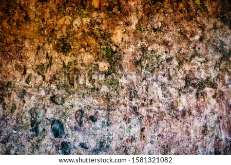 Years of patina and grime on an ancient monastery wall in Sintra Portugal #1581321082