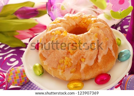 yeast ring cake decorated with icing and candied orange peel  for easter