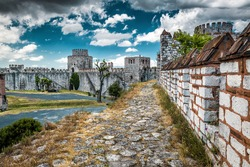 Yedikule Fortress, Istanbul, Turkey. Yedikule Castle is an old landmark of Istanbul. Panorama of the ancient Constantinople's walls in summer. Dramatic view of remains of Byzantine Empire in Istanbul.