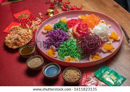 Yee Shang, Yusheng, yee sang or yuu sahng , or Prosperity Toss, also known as lo hei is a Cantonese-style raw seafood salad.Delicious and colorful display of Chinese prosperity cuisine / Yee Sang aka  Photo stock ©