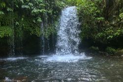 Yeh Ho Waterfall is located in the lush rice field-laden Penebel village in Tabanan.  Waterfall near to Jatiluwih rice terrace in Bali, Indonesia. Beautiful waterfall in deep tropical jungle.