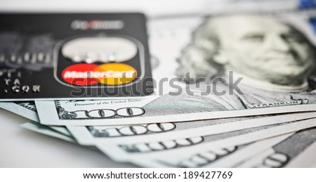 YEKATERINBURG, RUSSIA - APR 25, 2014: Mastercard Debit Card Over Dollar bills