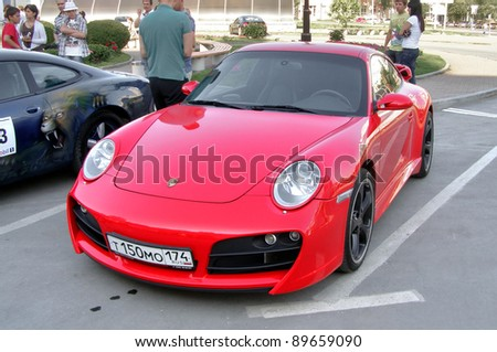 "YEKATERINBURG, RUSSIA - JULY 23: Porsche 911 (997) takes part at the annual Navigation rally ""Porsche Challenge"" on July 23, 2011 in Yekaterinburg, Russia."