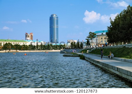 YEKATERINBURG, RUSSIA - JULY 25: View from the city pond to Vysotsky skyscraper on July 25, 2010 in Yekaterinburg, Russia. With height of 188.3 m it is the tallest building in Russia outside Moscow.