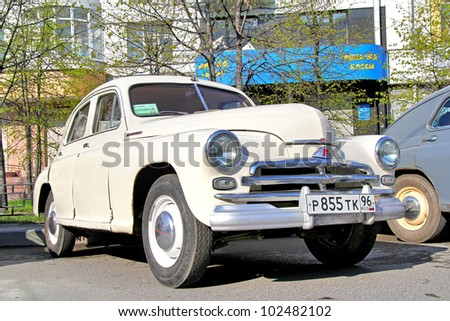 "YEKATERINBURG, RUSSIA - MAY 9: Soviet motor car GAZ-M20 ""Podeda"" exhibited at the annual Victory day Parade on May 9, 2012 in Yekaterinburg, Russia."