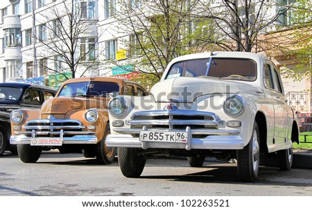 """YEKATERINBURG, RUSSIA - MAY 9: Soviet motor car GAZ-M20 """"Podeda"""" exhibited at the annual Victory day Parade on May 9, 2012 in Yekaterinburg, Russia. - stock photo"""
