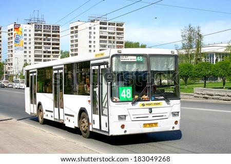 YEKATERINBURG, RUSSIA - MAY 8, 2010: White NEFAZ 5299 city bus at the city street.