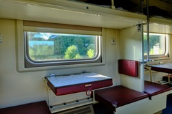 Yekaterinburg, Russia - September 8, 2020. The train goes across Russia. View of the compartment of a reserved seat carriage.