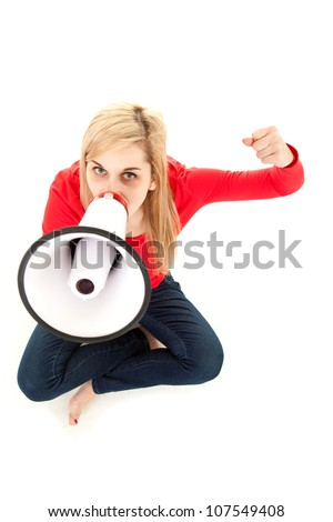 yelling young woman with megaphonesnd raised fist, full length, white background