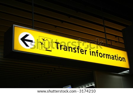 Yellow airport transfer sign