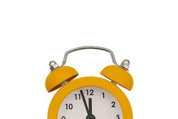 Yellow alarm clock on a white background with copy space. Antique clock. Sale reminder, hot prices. Deadline for the delivery of the project