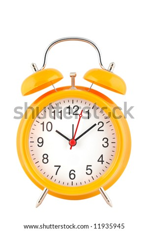 Yellow alarm clock with bells on top isolated over white background