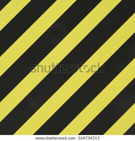 Yellow and black diagonal stripes as an abstract pattern background