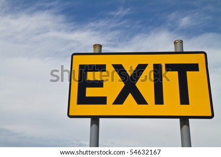 Yellow and Black Exit Sign against a cloudy and blue  sky - stock photo