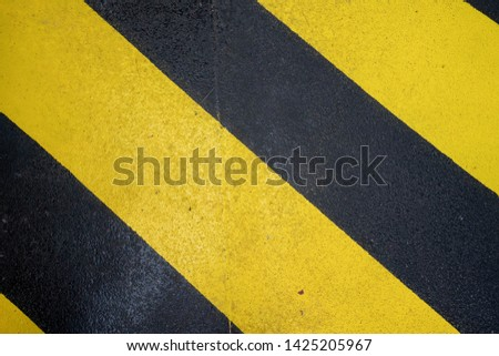 Yellow and black non slip surface area on boat to keep passengers from slipping when wet
