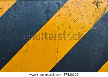 yellow and black road marking
