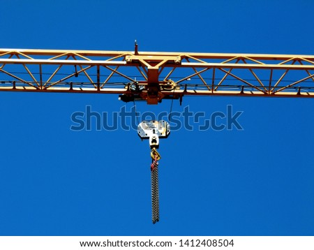 yellow and black steel truss tower crane detail under blue sky. construction industry concept. part of hoisting and lifting device.  #1412408504