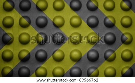 Yellow and black warning sign on bubble texture. - stock photo