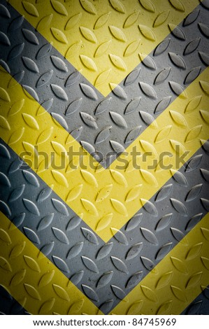 Yellow and black warning sign on Metal Plate