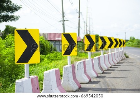 Yellow and Black Way sign for milestone. Travel planning. Signs and Symbols. #669542050