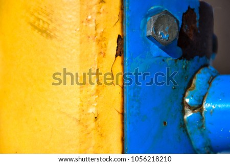 Yellow and blue painted steel parts bolted together