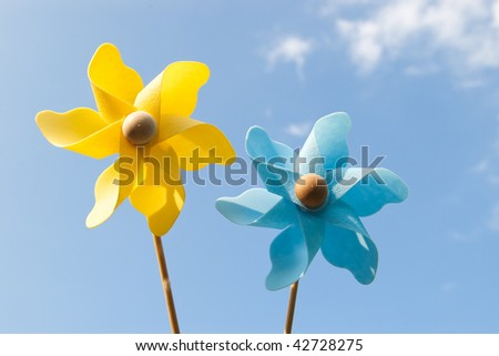 yellow and blue pinwheels on sky