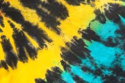 yellow and blue tie dye stripe pattern.