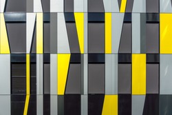 Yellow and Gray Decorative Facade Cladding Panels of Irregular Shapes. Geometric Facade. Modern Building. Abstract Architecture Photography.