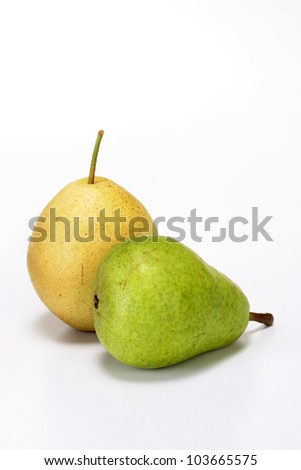 Yellow and green pears on white
