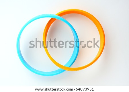 Yellow and light blue rubber bracelet. Yellow is colour of King, light blue is Queen of  Thailand.