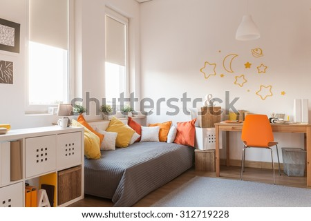 Yellow and orange accessories in modern teen room #312719228