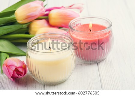 Yellow and pink aroma candles with tulips. SPA composition. Toned vintage #602776505