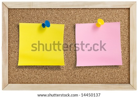 Yellow and pink remainder notes on cork board, with tacks.