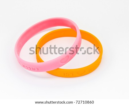 Yellow and pink rubber bracelet. Two colors of King of Thailand.