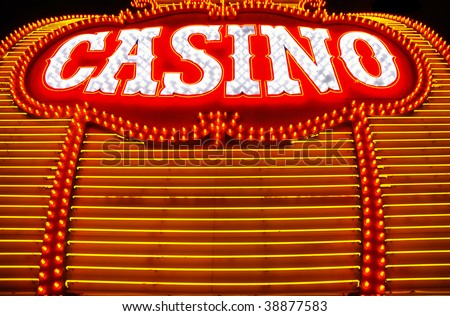 Yellow and red neon lights surround casino sign